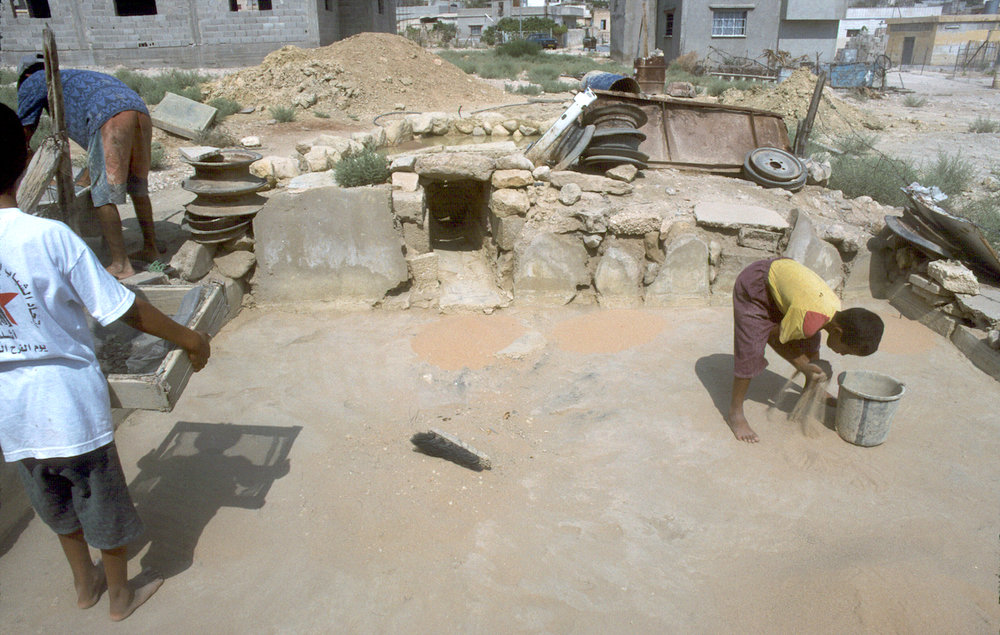 sifting-spreading sand in basin.jpg
