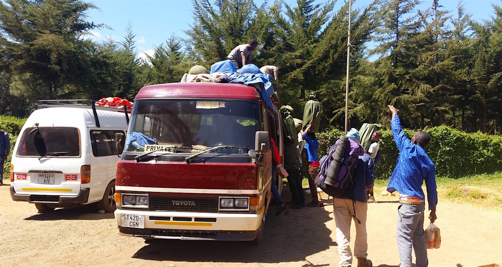 After the organized shuffle, all bags were reloaded on the top of the bus.
