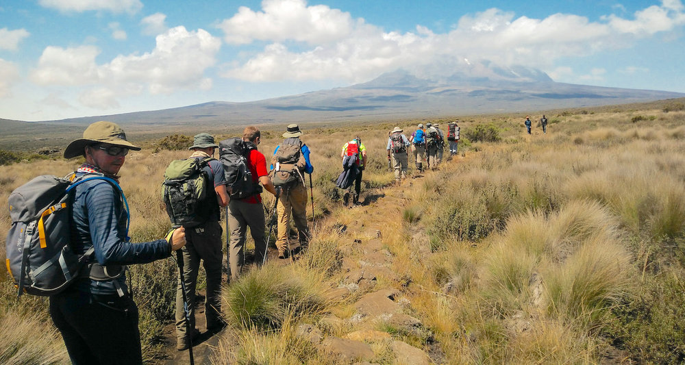 Trekking across the caldera known as the Shira Plateau. Our noses are pointed to Kibo. Photo by teammember Nico Roger.