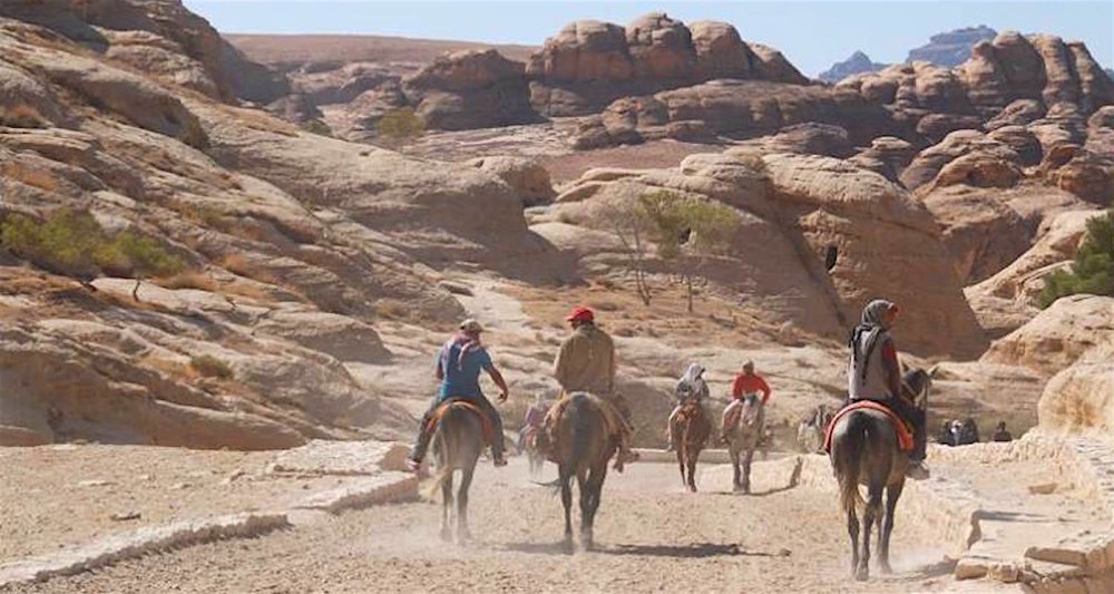Riding into Petra, Jordan.