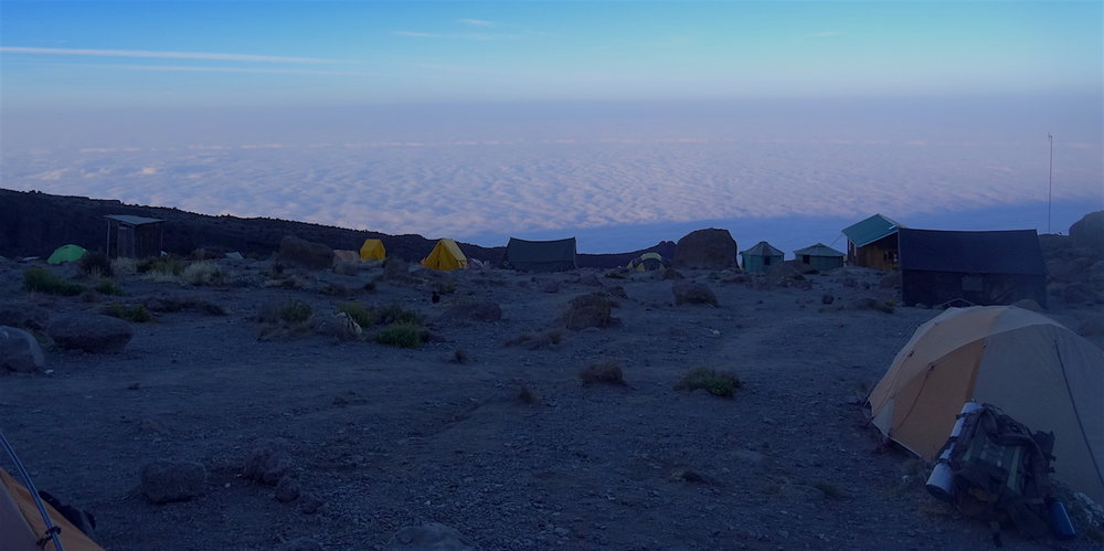 Evening view from Karanga Camp. The African plain is covered by clouds. Image by teammember Nico Roger.