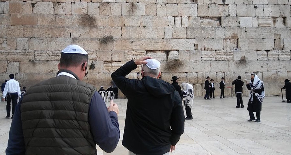 Visiting the Western Wall in Jerusalem.