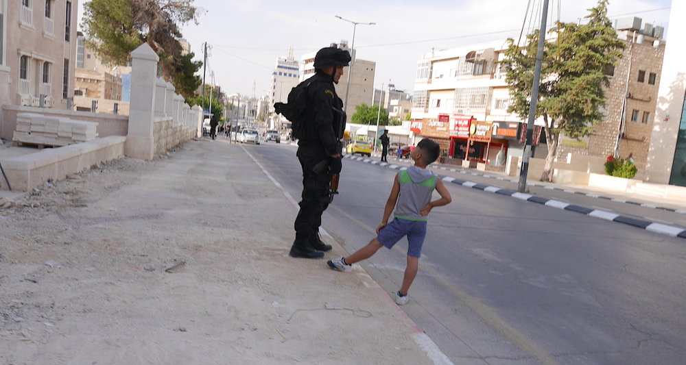 Palestinian policemen lined the streets.