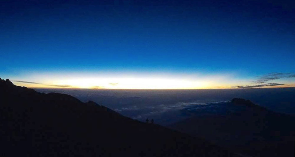 The sun rises on Kilimanjaro's rim. I think Rachel shot this image.