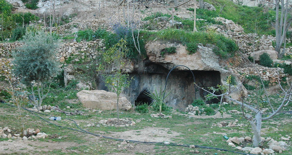 There are a number of Second Temple Period tombs in the lower reaches of the Hinnom Valley in Jerusalem. This one is in somebody's backyard.