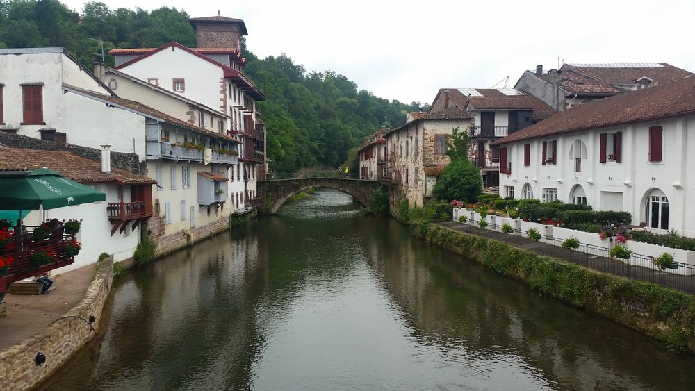 The white stucco buildings of Saint-Jean-Pied-de-Port crowd the River Nive.