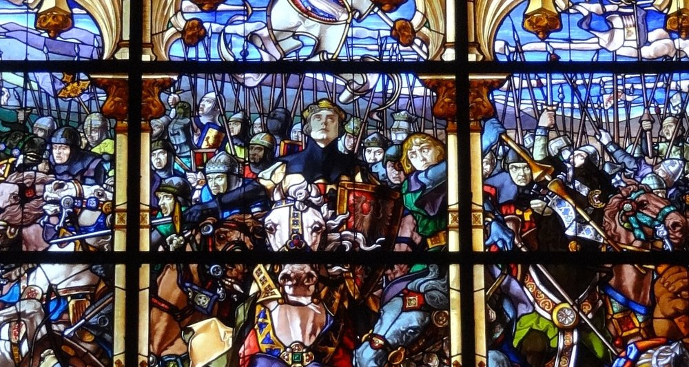 This set of stained glass windows is found in the Real Colegiata de Santa María in Roncesvalles. It depicts Roland and his men in battle. The work was completed in 1909 by Jose Maumejean. See the full display    here.