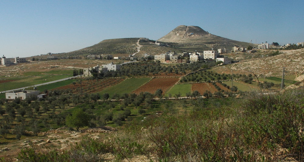 View to the Upper Palace of the Herodyon (Arab, Jabal al-Fourdis). This complex, carrying the name of Herod himself, was constructed atop a natural mount (on right), made still higher by artificial fill. Nesting on the summit is a circular fortress offering spectacular views in all directions. Excavations on the north slope (facing the camera) have revealed the final resting place of this infamous king from the Christmas story.