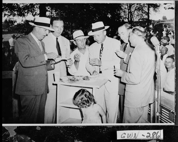 lawrenceville, 1948 - citizens gather at a political rally.  from left to right: senator richard russell, roy gunner, sol corbin, marvin allison, bob duncan, and unknown individual.  mr. allison is in the middle with a white hat and a tie.