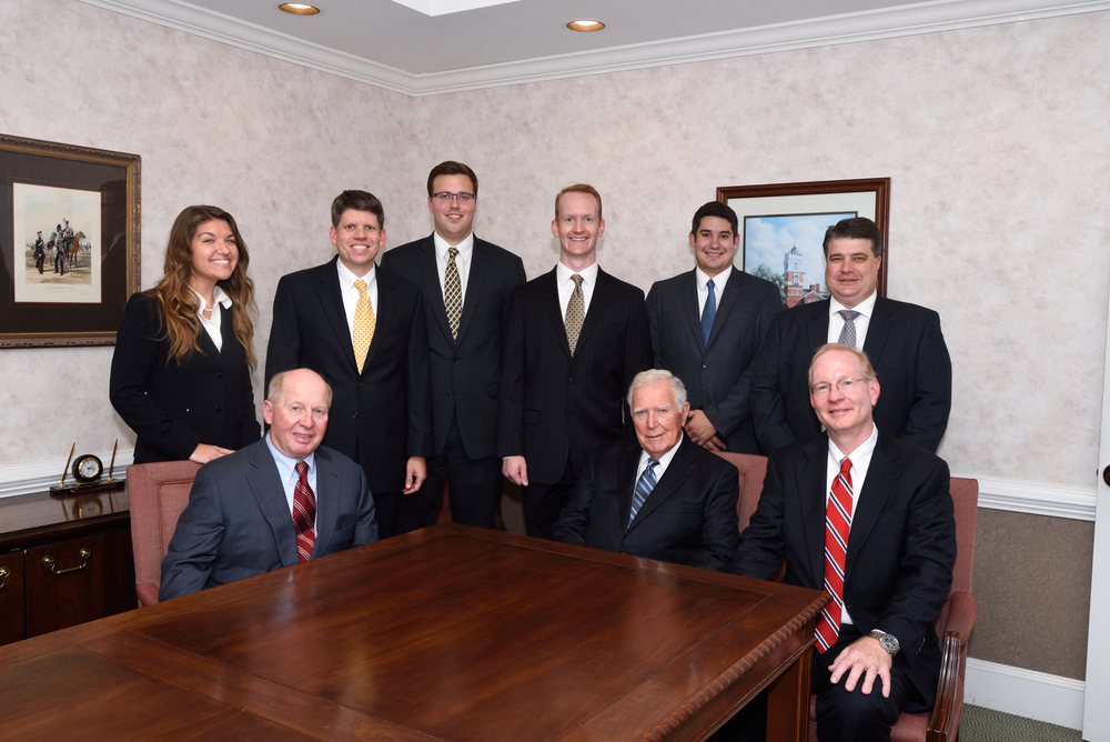 the lawyers: from Front left to right: bill tanner, jones webb, tony powell; rear left to right: ashley scarpetta, brian edwards, chris day, nathan powell, joseph emanuel, and chuck ross