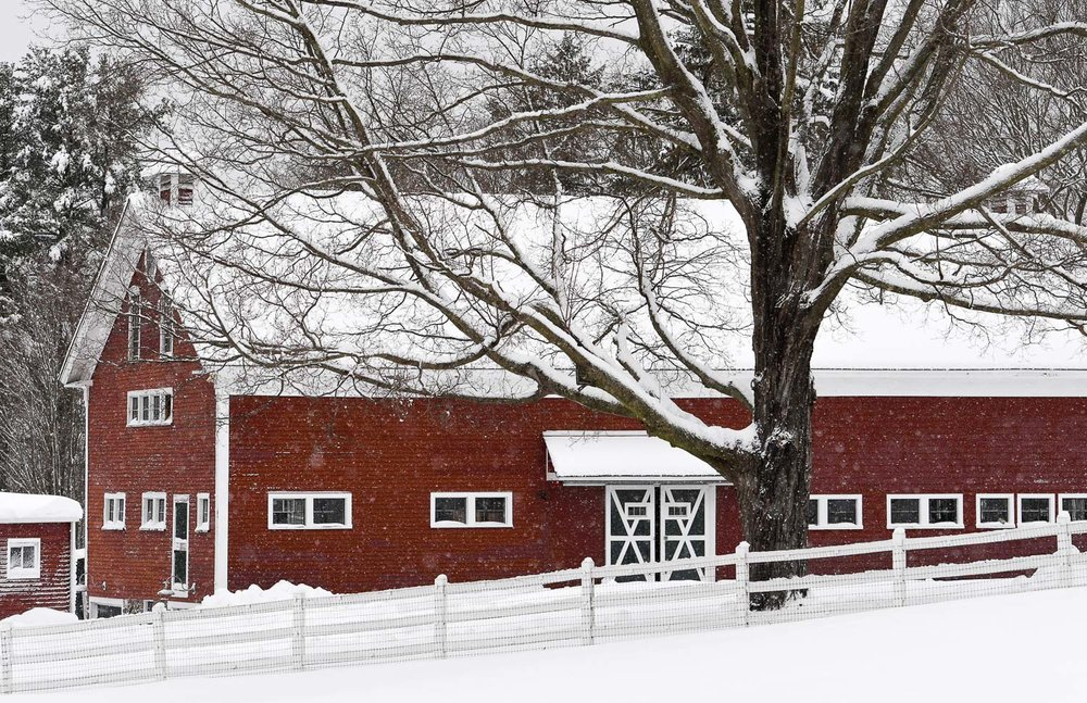 Nikon D500, 1/320 @ f/5, ISO 100, 70-200mm  One of the barns on the property of Meredith Farm in Topsfield seen with a fresh coat of snow.
