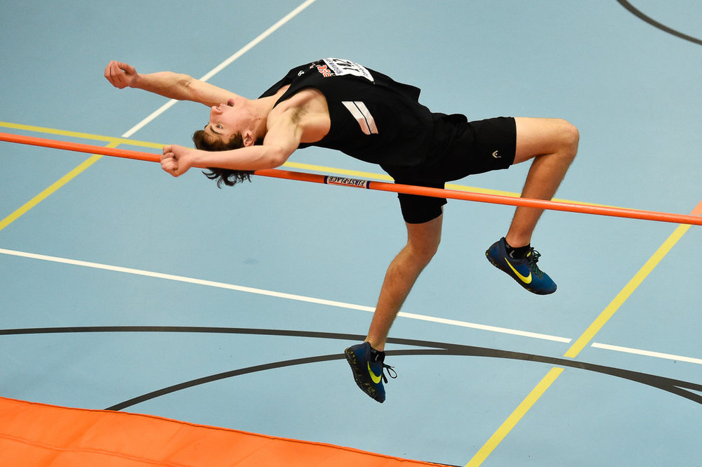 Nikon D4s, 1/1,000 @ f/2.8, ISO 5,000, 70-200mm Nate Rogers of Ipswich competes in the high jump during their indoor track meet at Ipswich High School.