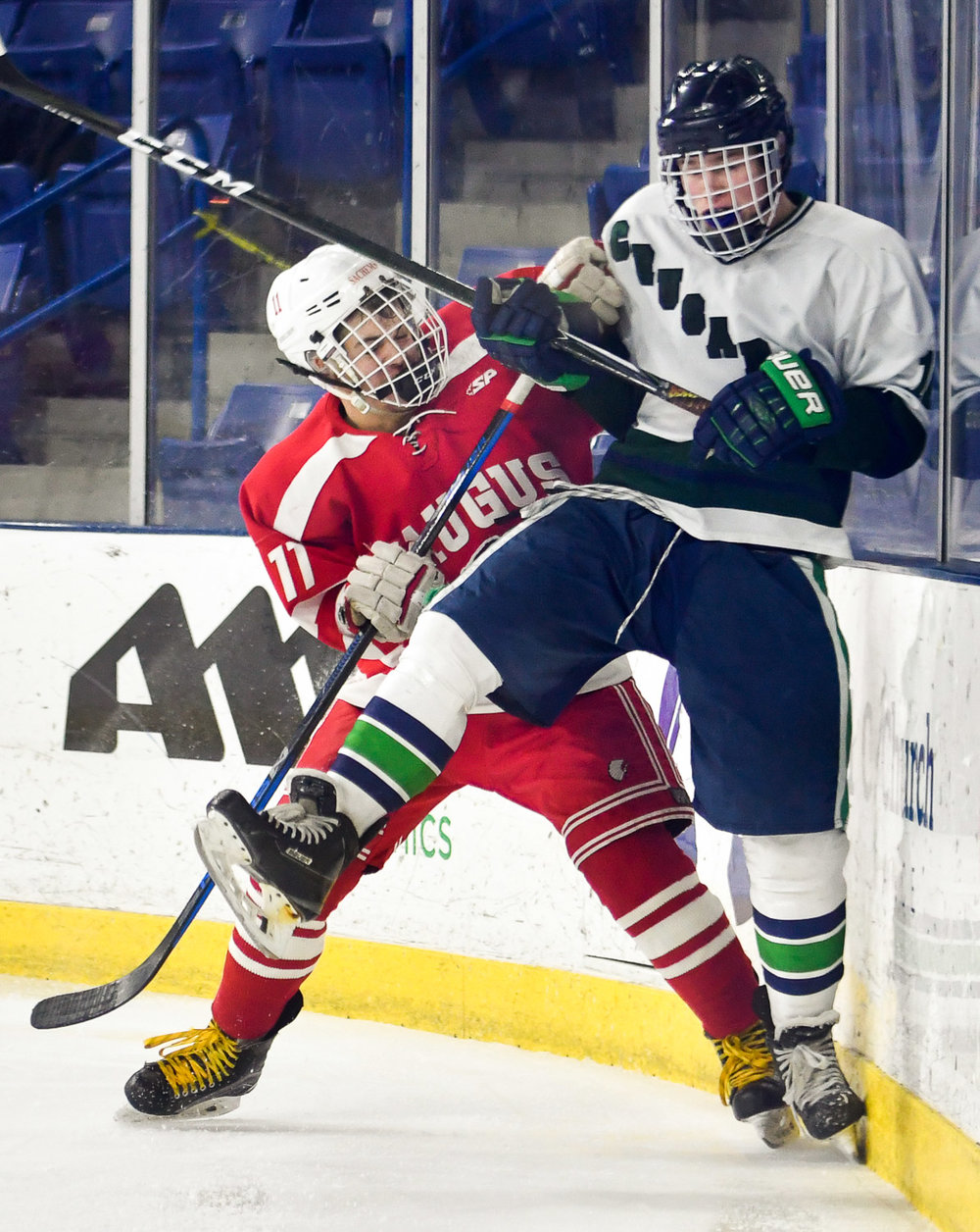 Nikon D4s, 1/1,250 @ f/2.8, ISO 1,250, 70-200mm Ryan Groark of Saugus checks Michael Talbot of Lowell Catholic against the boards during their game at the Tsongas Center at UMass Lowell.