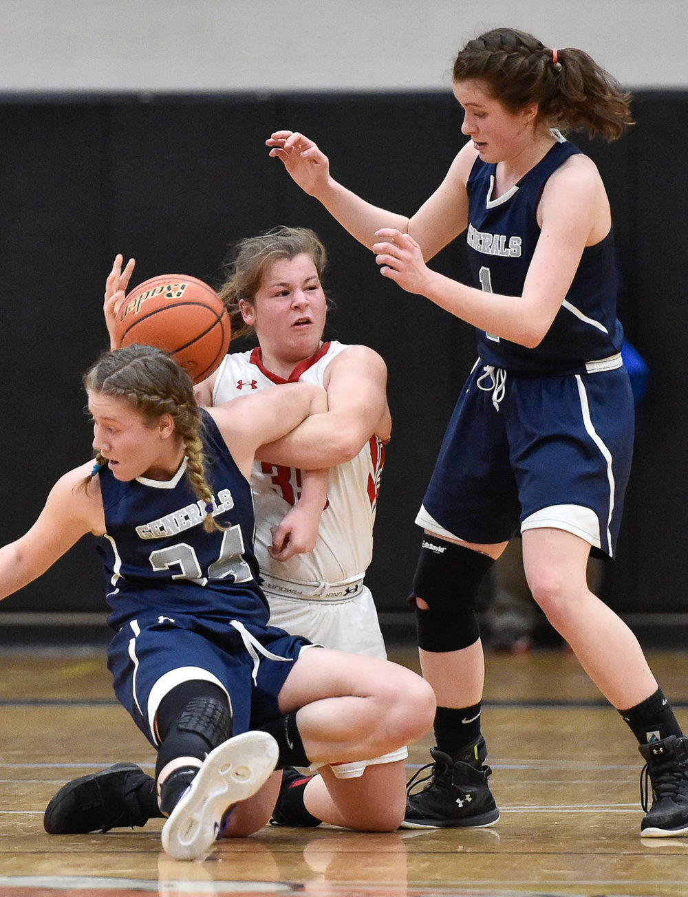 Nikon D4s, 1/1,000 @ f/2.8, ISO 6,400, 70-200mm  Hannah Dziadyk of Wakefield holds onto the ball as she is defended by Elizabeth Kirschner and Lauren Flynn of Hamilton Wenham during Wakefield's D2 North tournament game loss, 54-53, at Woburn High School.