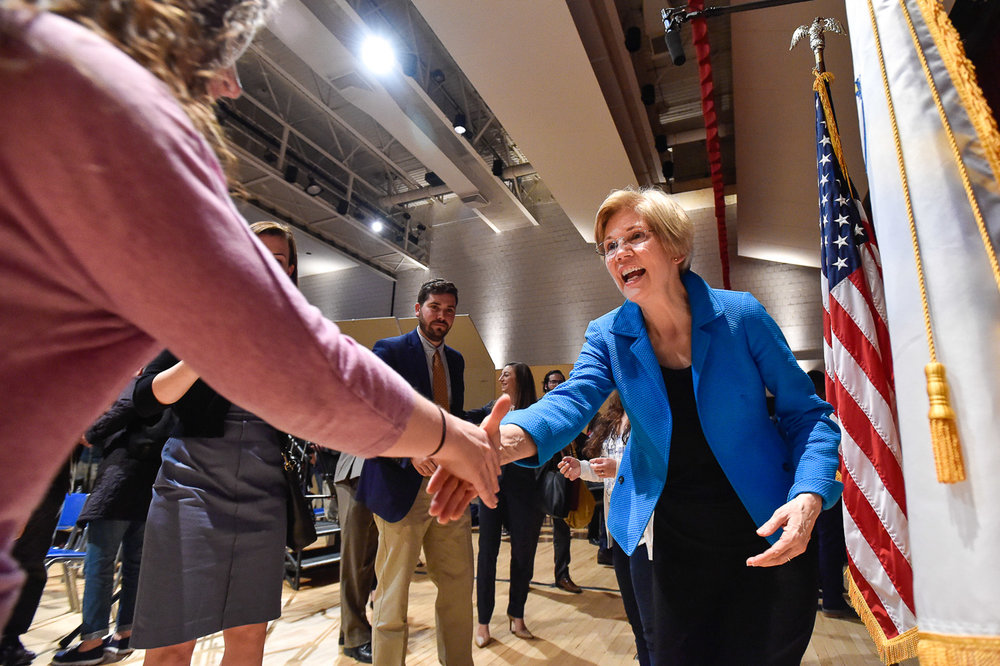 Nikon D4s, 1/250 @ f/4, ISO 6400, 17-35mm  Senator Elizabeth Warren shakes hands with a supporter at the conclusion of the town hall at Salem High School, Thursday, April 13, 2017. [Wicked Local Staff Photo / David Sokol]
