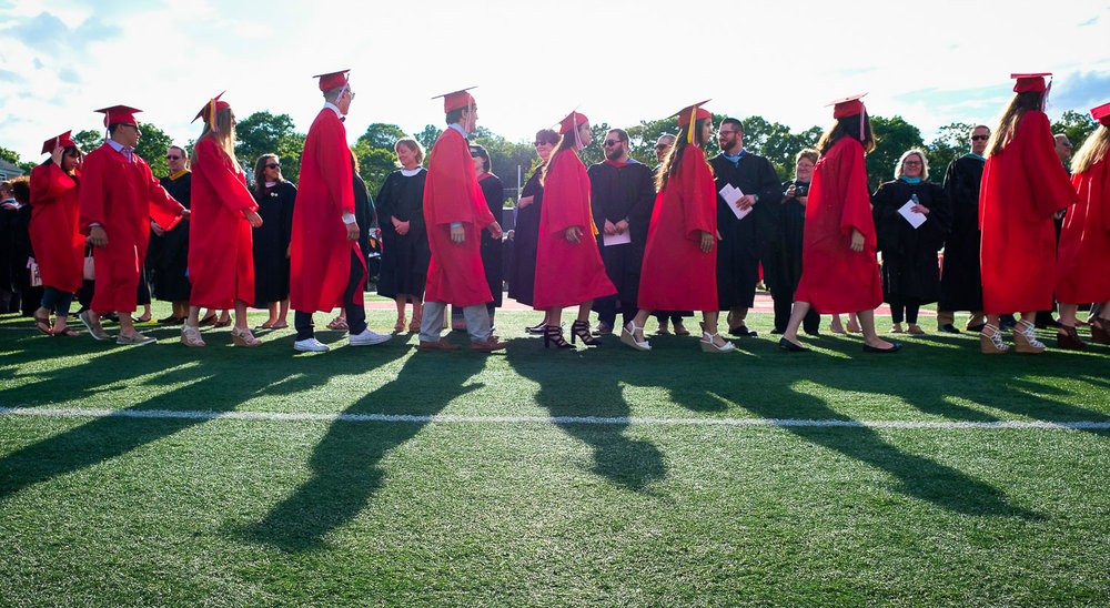 Fuji XT-2, 1/250 @ f/6.4, ISO 200, 18-55mm  Graduates march onto Fred Green Memorial Field during the start of the Melrose High School Graduation Ceremony, Friday, June 2, 2017. [Wicked Local Staff Photo / David Sokol]