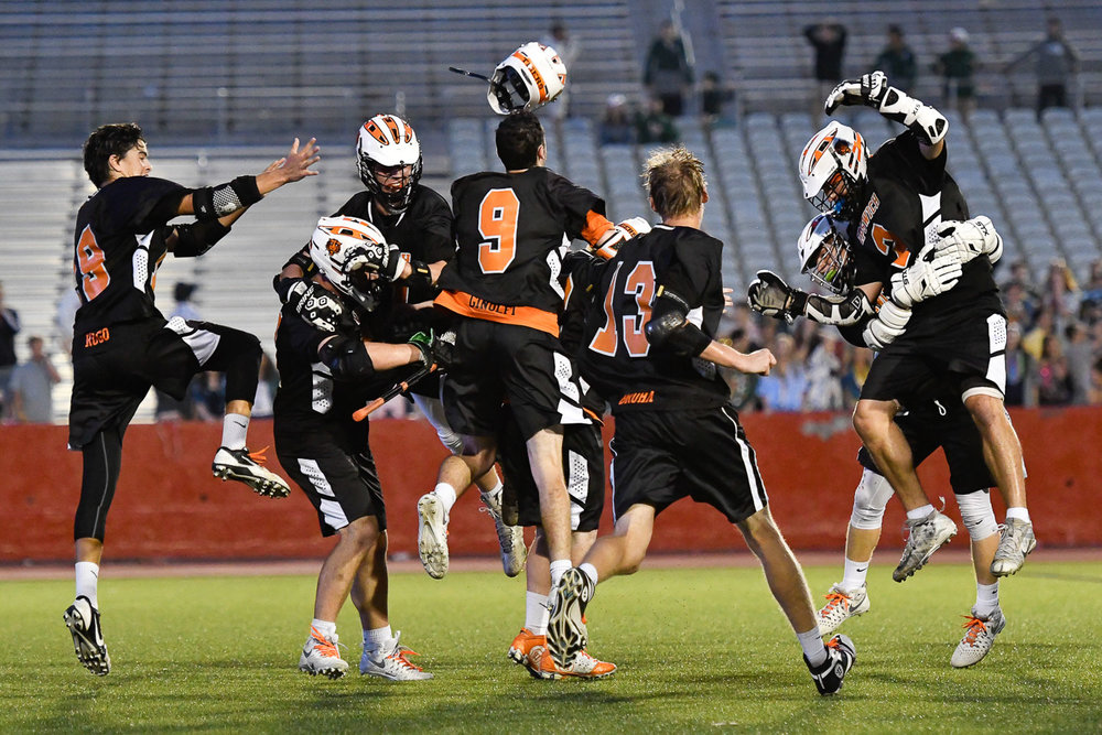 Nikon D500, 1/1250 @ f/2.8, ISO 4,000, 70-200mm  Members of the Ipswich boys lacrosse team celebrate at the conclusion of their Division 3 state championship win over Grafton, 8-7, at Nickerson Field at Boston University, Saturday, [Wicked Local Staff Photo / David Sokol]