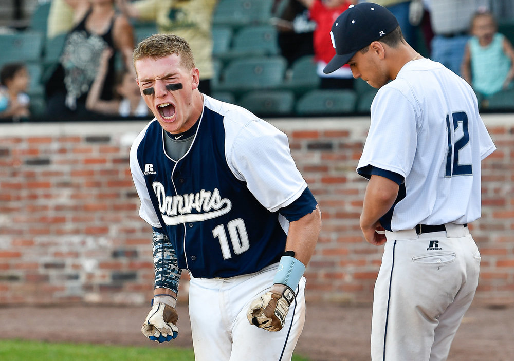 Nikon D500, 1/320 @ f/4.5, ISO 140, 70-200mm Danvers High School athletes Matt Andreas, left, and Justin Roberto, right, react at the conclusion of their Division 2 state finals loss to Greater New Bedford, 6-2, at Campanelli Stadium in Brockton, Thursday, June 15, 2017. [Wicked Local Staff Photo / David Sokol]