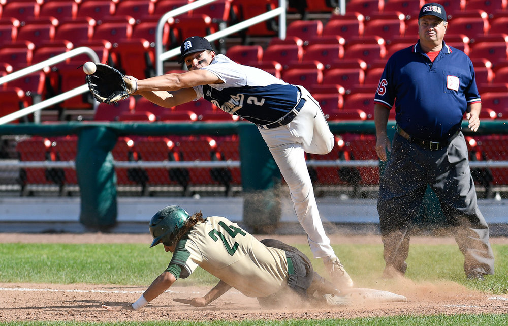 Nikon D500, 1/2500 @ f/4, ISO 200, 300mm  Thomas Mento of Danvers is unable to make this catch as Kevin Santigo of Greater New Bedford safely slides back into first base during their Division 2 state finals 6-2 loss at Campanelli Stadium in Brockton, Thursday, June 15, 2017. [Wicked Local Staff Photo / David Sokol]