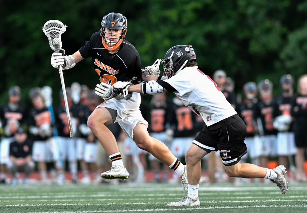 Nikon D500, 1/2000 @ f/3.2, ISO 2800, 300mm  Chris Cole of Beverly carries the ball as he is pressured by Tommy Welch of Hingham during their Division 2 state semi-finals loss, 17-5, at Norwell High School, Wednesday, June 14, 2017. [Wicked Local Staff Photo / David Sokol]