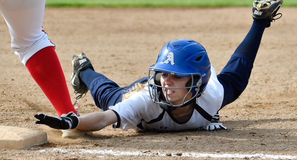 Nikon D500, 1/3200 @ f/4.5, ISO 500, 70-200mm  Sarah Ryan of Swampscott reaches for the bag as she safely slides into home plate during their 3-1 win over Burlington in their Division 2 North tournament game at Endicott College, Friday, June 9, 2017. [Wicked Local Staff Photo / David Sokol]