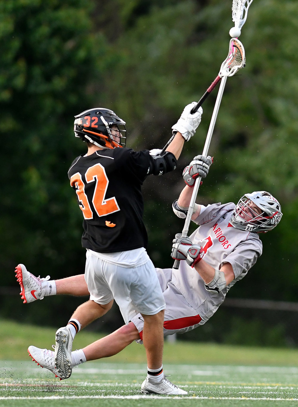 Nikon D500, 1/2000 @ f/2.8, ISO 1250, 300mm  Ryan Fitzpatrick of Wakefield gets checked by Tom Adams of Beverly during their Division 2 North championship game loss, 7-6, at Concord Carlisle High School, Saturday, June 10, 2017. [Wicked Local Staff Photo / David Sokol]