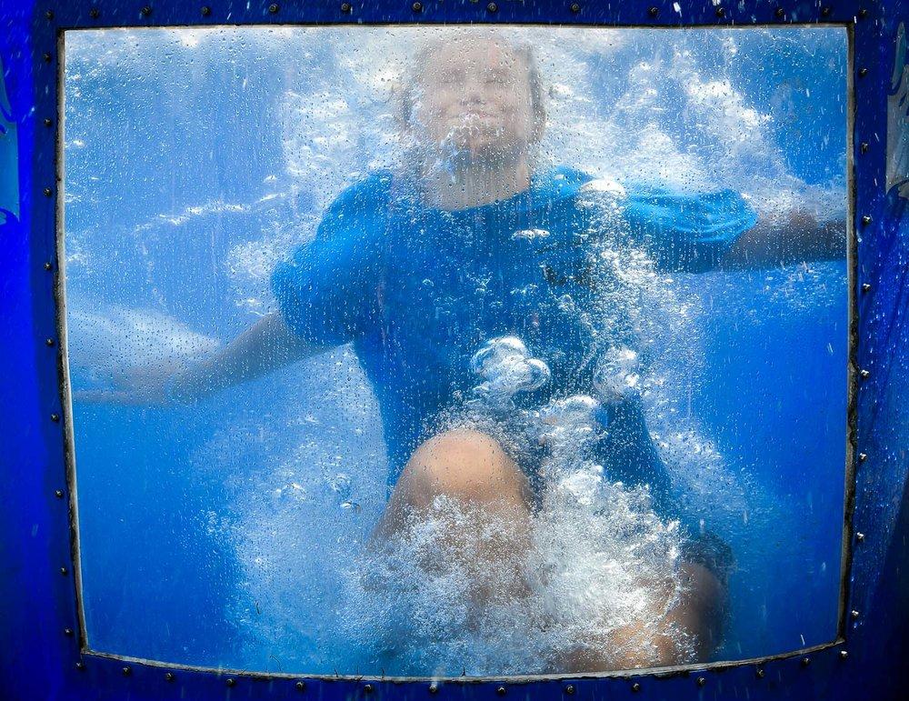 Nikon D500, 1/320 @ f/7.1, ISO 140, 70-200mm Danielle Dedeo, Adventure Camp councilor, gets soaked in the Dunk Tank during the Kids Carnival at Lynch Park, Friday, Aug. 4, 2017. [Wicked Local Staff Photo / David Sokol]