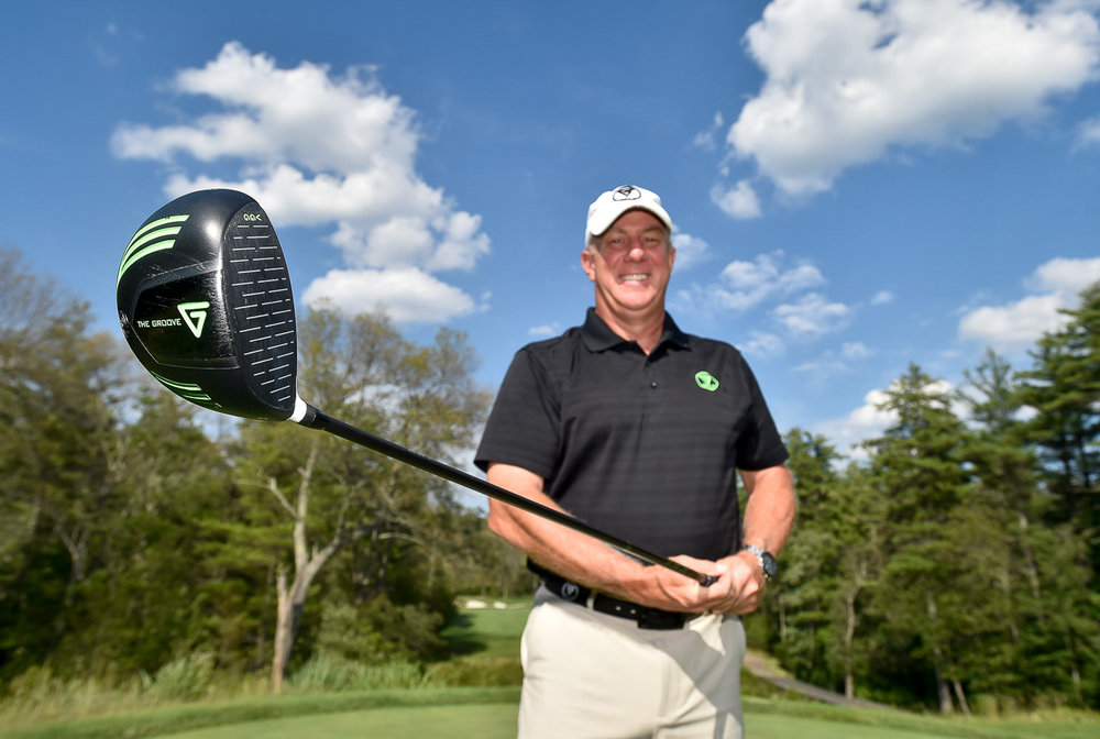 Nikon D4s, 1/320 @ f/7.1, ISO 100, 17-35mm  Jeff Barry, CEO of Vertical Groove Golf, poses for a photo with his Vertical Groove Golf titanium driver at the Turner Hill Golf Club in Ipswich, Monday, July 10, 2017. [Wicked Local Staff Photo / David Sokol]
