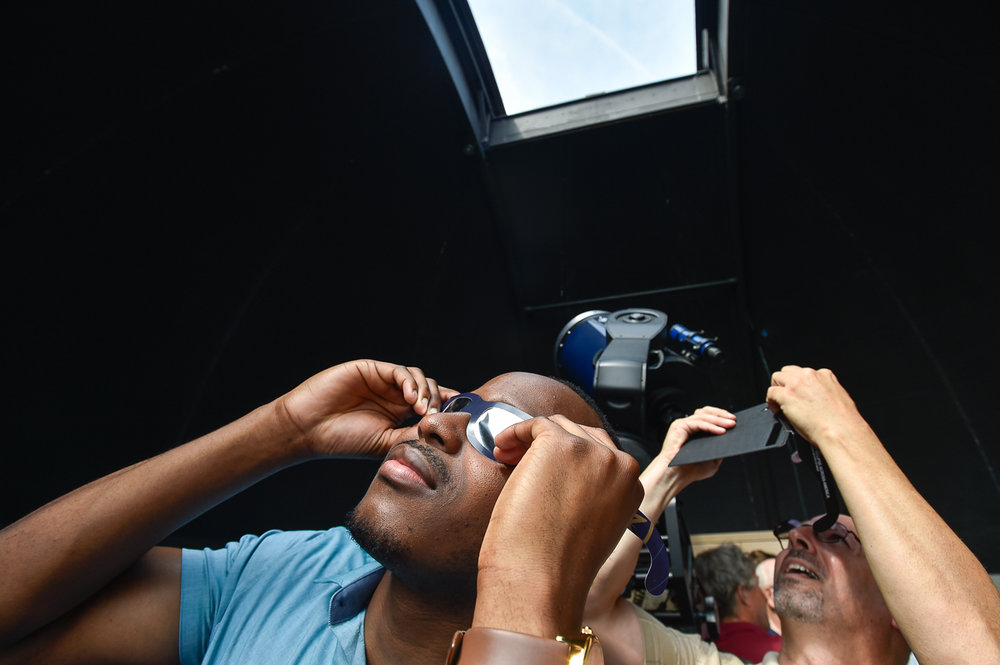 Nikon D4s, 1/160 @ f/6.3, ISO 125, 17-35mm Chris Nzuka, left, and Brian Helman, right, view the partial solar elcipse during a free public solar-eclipse viewing party at Salem State University, Monday, Aug. 21, 2017. [Wicked Local Staff Photo / David Sokol]