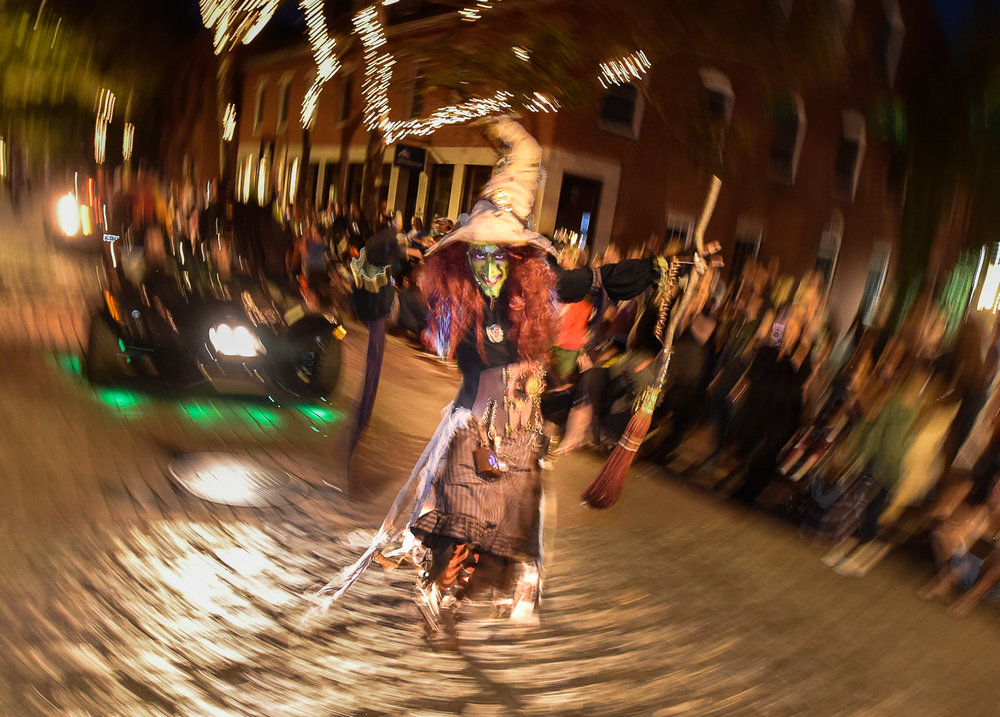 Nikon D4s, 1/13 @ f/4.5, ISO 3200, 17-35mm  A person dressed as a witch scares people along Front Street during the Haunted Happenings Grand Parade in downtown Salem, Thursday, Oct. 5, 2017.