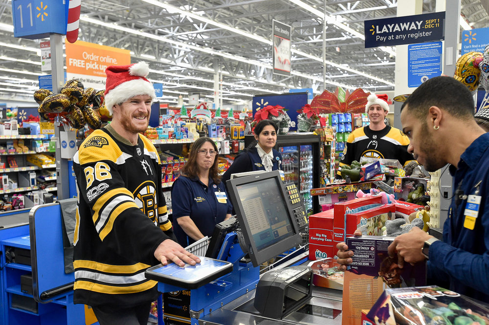 Nikon D4s, 1/250 @ f/5.6, ISO 3200, 17-35mm  Kevan Miller, Boston Bruins defenseman, smiles as he check-out during the Bruins Annual Holiday Toy Shopping event at Walmart in Saugus where gifts purchased by members of the Boston Bruins will be donated to area hospitals around Boston for children who are unable to celebrate the holidays at home, Thursday, Nov. 30, 2017. [Wicked Local Staff Photo / David Sokol]