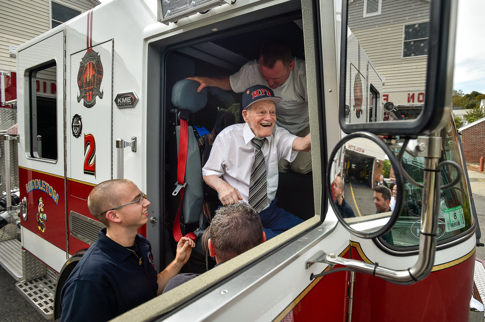 Honorary Middleton firefighter Bobby Jensen is helped into Middleton Engine 2 as he prepares to go for a ride around the block during his visit at the Middleton Fire Department, Thursday, Sept. 14, 2017. [Wicked Local Staff Photo / David Sokol]