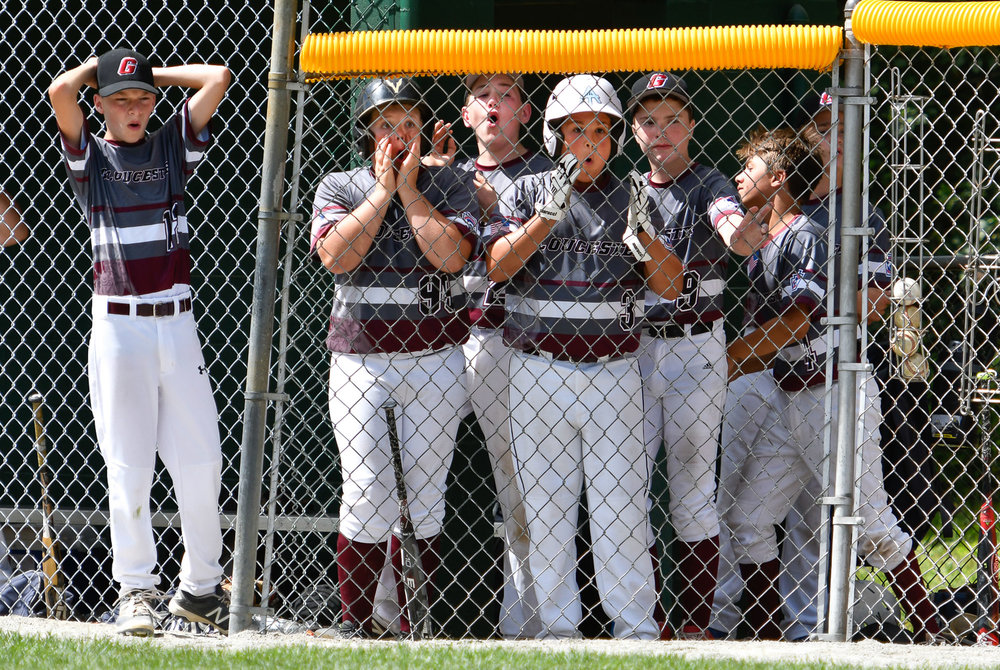 Members of the Gloucester All Star team react as the final out of the game is called during their Little League All Stars State Final loss to Holden, 13-9, at the Benevento Complex in North Reading, Sunday, July 30, 2017. [Wicked Local Staff Photo / David Sokol]