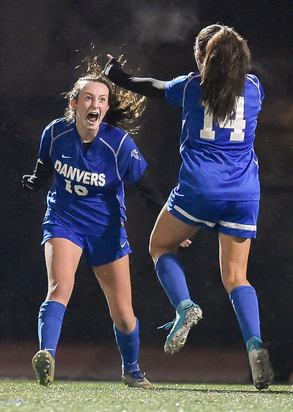 Riley Baker and Abby Cash of Danvers celebrate the teams only goal during their 1-0 MIAA Div. 2 North Sectional Finals win over Winchester at Manning Field in Lynn, Monday, Nov. 13, 2017. [Wicked Local Staff Photo / David Sokol]
