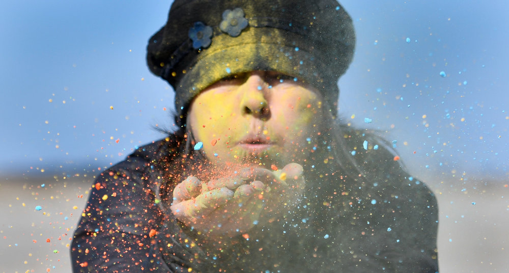 2nd Place, Photo Illustration  Kerrie Bates, Director of Ipswich ReCreation and Culture, blows colored powder cornstarch into the air at Crane Beach to promote the upcoming Ipswich Spring Equinox Extravaganza at Crane Beach on Monday, March 13, 2017. [Wicked Local Staff Photo / David Sokol]
