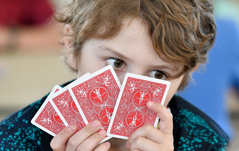 2nd, News Feature Photo  Nico Altoniaa, 10, takes a close look at his hand of cards during a cribbage game between students from the Village School and seniors from the Senior Center at the Old Town House on Thursday, June 15, 2017. [Wicked Local Staff Photo / David Sokol]