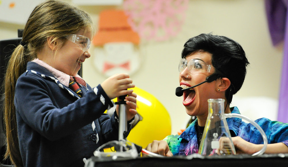 "1st Place, Personality Photo  Arabella Pelekoudas, 7, and Aspen Ridge, of Sciencetellers, react after using pressure in one of their science experiments during the Sciencetellers program, ""Power and Energy"" at the Swampscott Public Library on Monday, Aug. 1, 2016. Wicked Local Staff Photo / David Sokol"