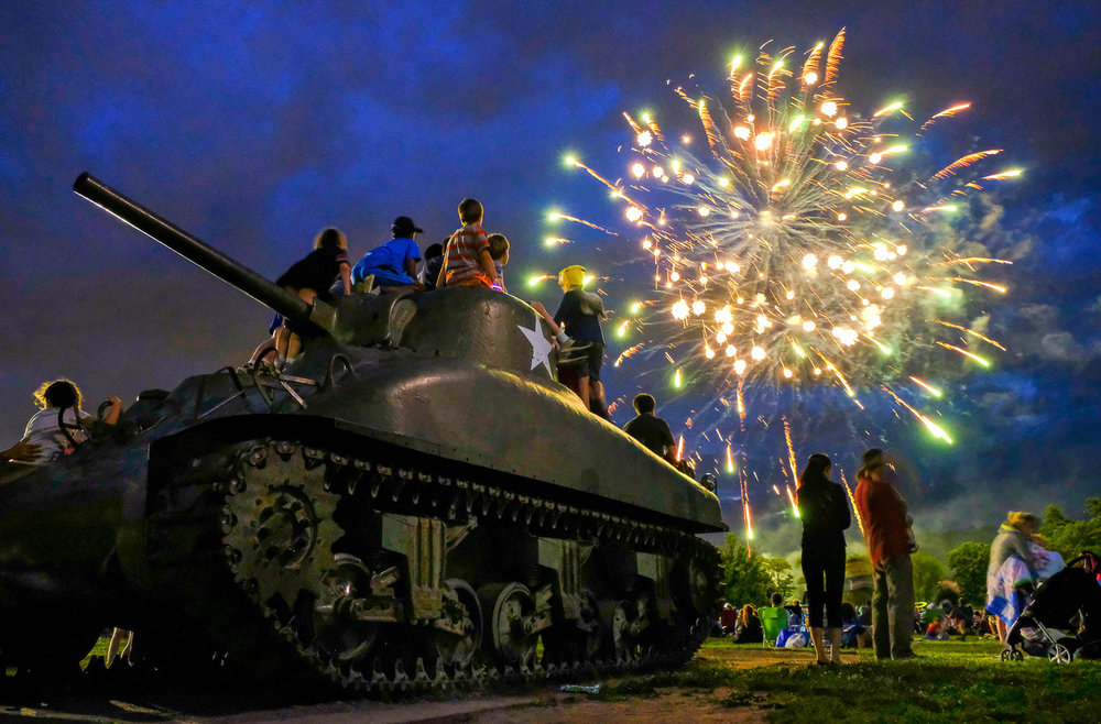 1st Place, News Feature Photo  People enjoy a fireworks display and music at Patton Park in Hamilton at the conclusion of the Community Block Party, Sunday, June 25, 2017.