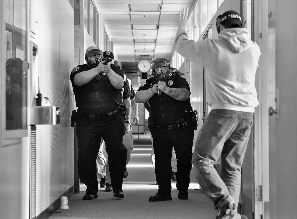 Nikon D4s, 1/1,000 @ f/4, ISO 12,800  Lawrence patrolman Keith Salach, left, and patrolman Carlos Vieira, right, take part in an active shooter training at Osgood Landing on Wednesday, April 18, 2018. [Wicked Local Staff Photo / David Sokol]