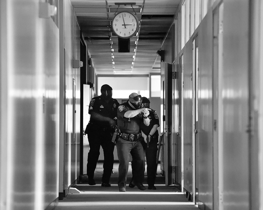 Nikon D4s, 1/1,000 @ f/4, ISO 18,000  North Andover police Sergeant Fredy Almanzar, left, officer Jason Wedge, center, and Ashley Kneeland, right, take part in an active shooter training at Osgood Landing on Wednesday, April 18, 2018. [Wicked Local Staff Photo / David Sokol]