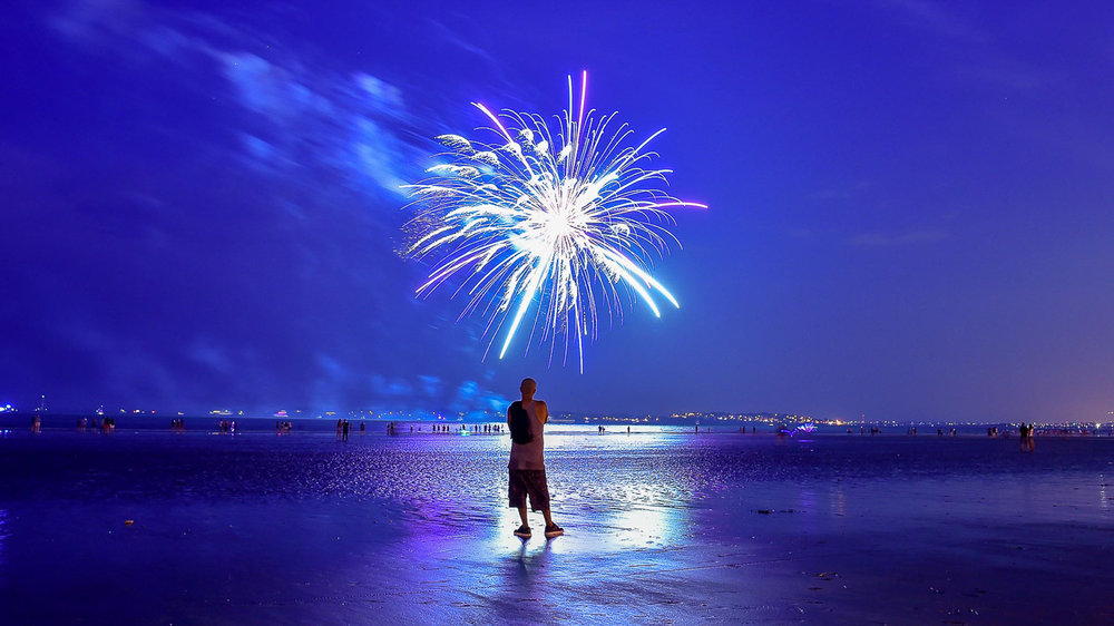 Third Place Pictorial:  A man watches the fireworks display over Kings Beach in Swampscott on Tuesday, June 3, 2018. [Wicked Local Staff Photo / David Sokol]