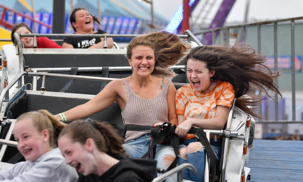 Second Place Feature:  Emma Fuller and Brooke Deary take a ride on the Arctic Blast roller coaster during the 91st annual St. Peter's Fiesta in Gloucester on Wednesday, June 27, 2018. [Wicked Local Staff Photo / David Sokol]