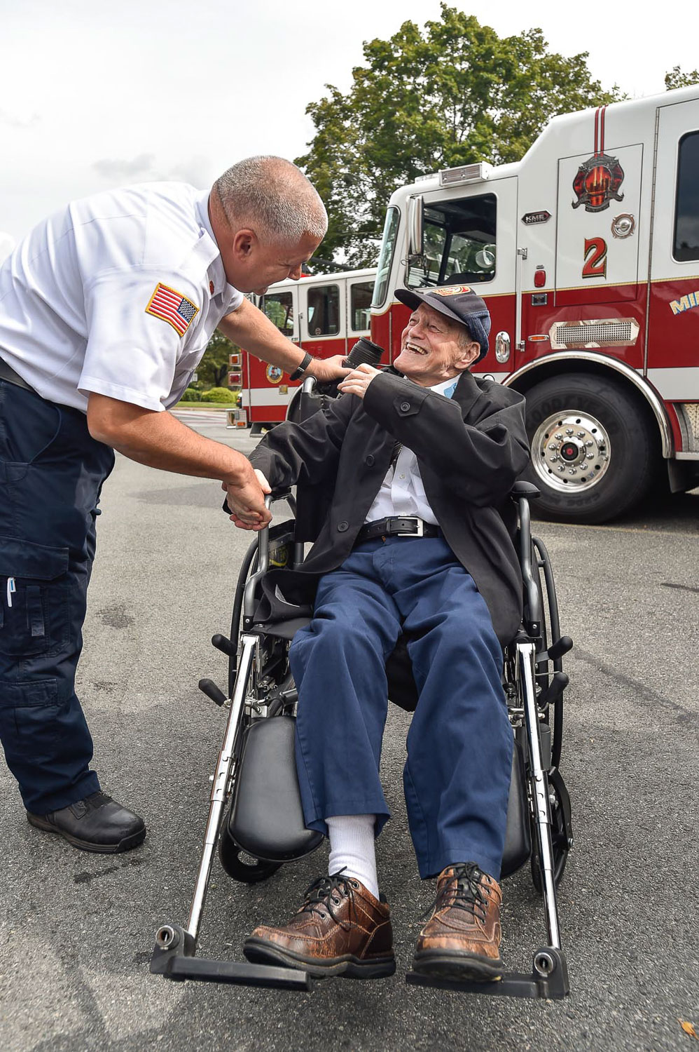 Second Place Photo Series:  1 of 9 Middleton Fire Chief Thomas Martinuk greets Bobby Jensen, who was named a honorary Middleton firefighter, during his visit at the Middleton Fire Department, Thursday, Sept. 14, 2017. [Wicked Local Photo / David Sokol]
