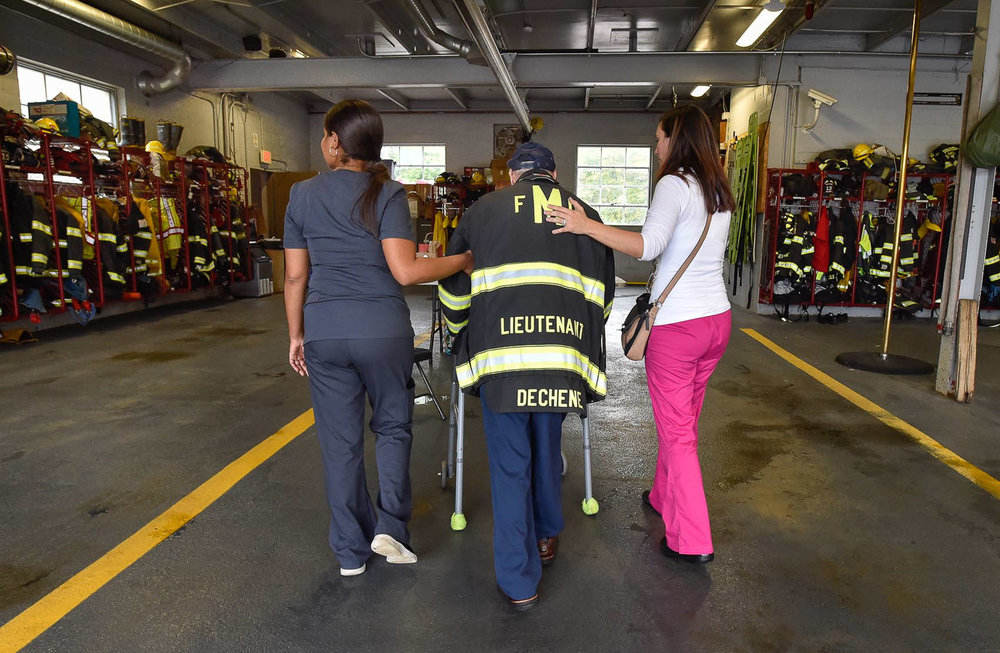 9 of 9 Honorary Middleton firefighter Bobby Jensen walks into the Middleton Fire station with assistance from Lismery Ortiz, Hospice Aide at Compassus, and Maureen Brancato, Hospice Nurse at Compassus, Thursday, Sept. 14, 2017. [Wicked Local Photo / David Sokol]