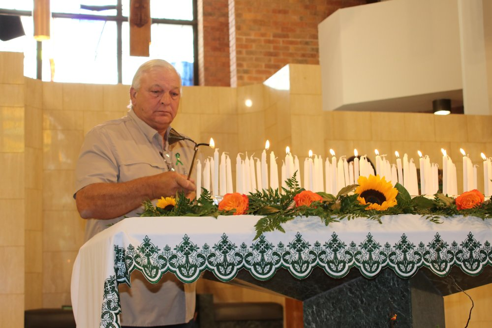 The lighting of candles in honor of donors at the 2016 gift of life & sight ceremony.