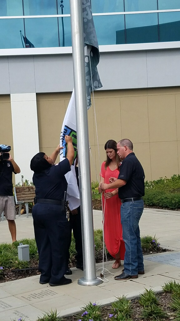 The Donate Life Flag is raised to honor Baby Clark Decell.