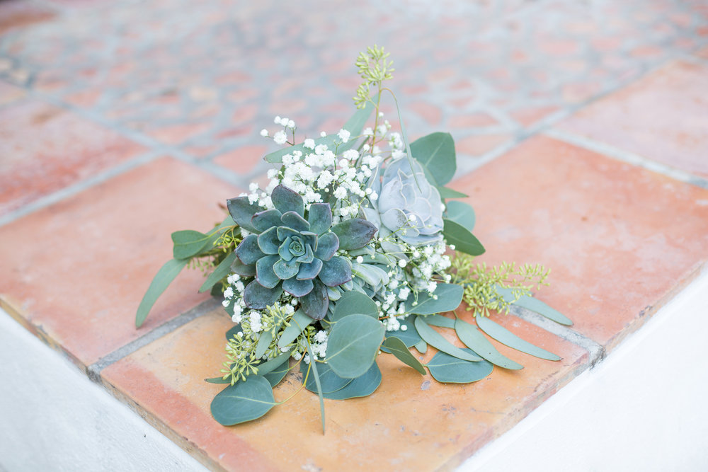 Beautiful succulent bouquet by Petals Florist.