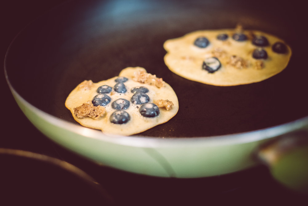 Heads up: If the batter is looking thin you're doing it right!  I flatten my pancakes on the first flip to release the blueberry juices. ;)