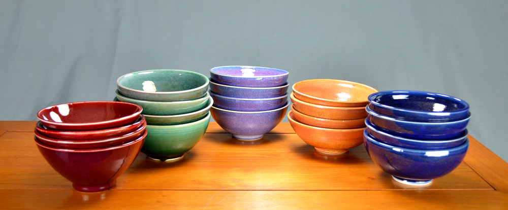 Porcelain Bowl Sets | Hand thrown porcelain on a potter's wheel.  High Fired, Cone 10, Assorted Colored Glazes, Hand Trimmed, Ceramic, Red, Green, Purple, Orange, Blue | Caldwell Pottery