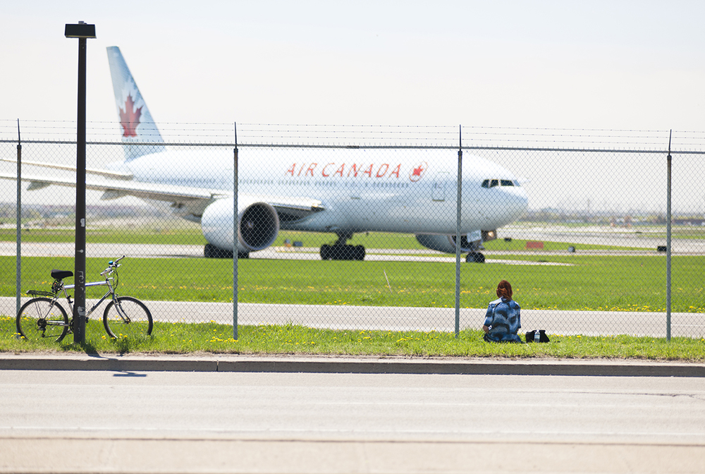 The Laird Co Planespotter Air Canada 777 Spring day bike fence airport aviation avgeek airline aiplane photography for site.jpg